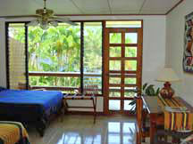Room at affordable Bed & Breakfast in rainforest with lakeview on Lake Arenal Costa Rica near La Fortuna Volcano in Nuevo Arenal Best breakfast best price. Gay Friendly View Casita bungalow Best Hotel